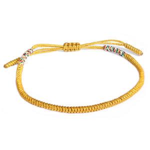Yellow buddhist bracelet